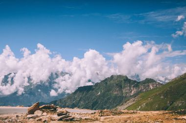 beautiful scenic mountain landscape and blue sky with clouds in Indian Himalayas, Rohtang Pass
