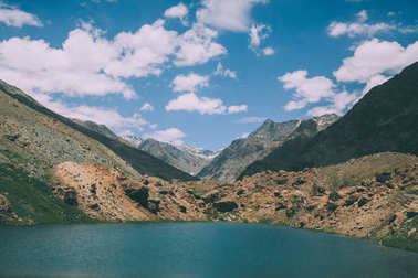beautiful landscape with calm lake and majestic mountains in Indian Himalayas