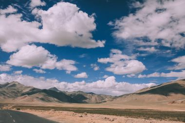 beautiful scenic mountain landscape and empty road in Indian Himalayas, Ladakh region