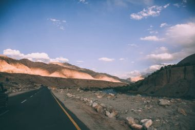 asphalt road and majestic rocky mountains in Indian Himalayas, Ladakh region