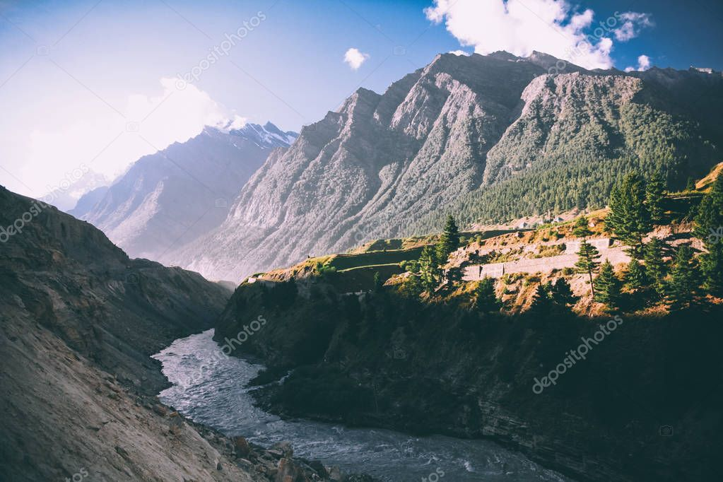 beautiful mountain river in valley and majestic mountains in indian himalayas