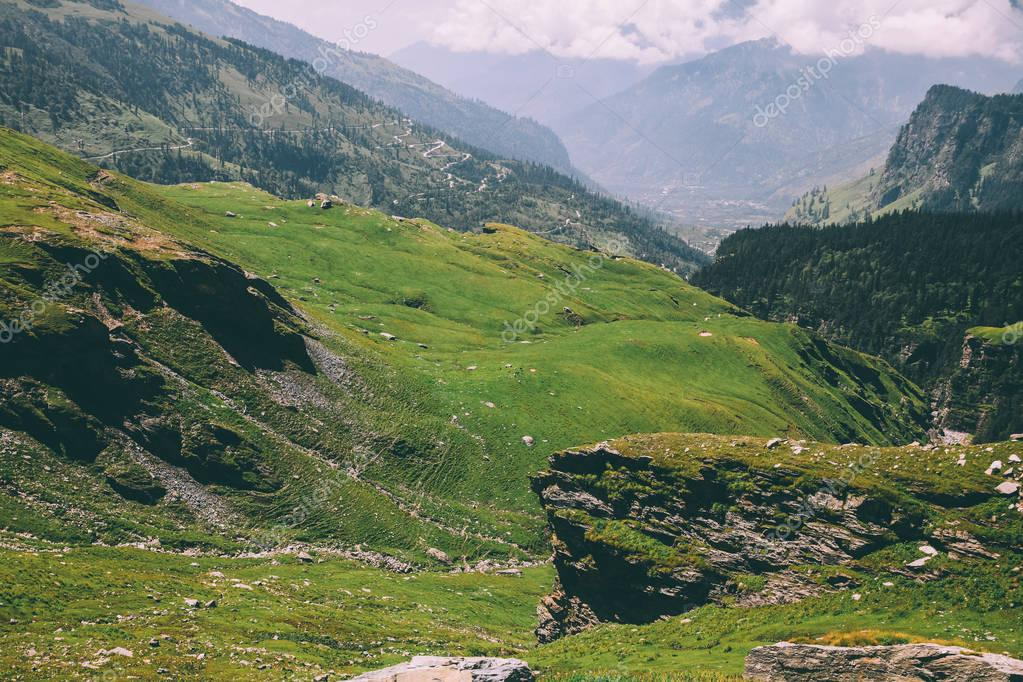 majestic rocky mountains covered with green grass and moss in Indian Himalayas, Rohtang Pass