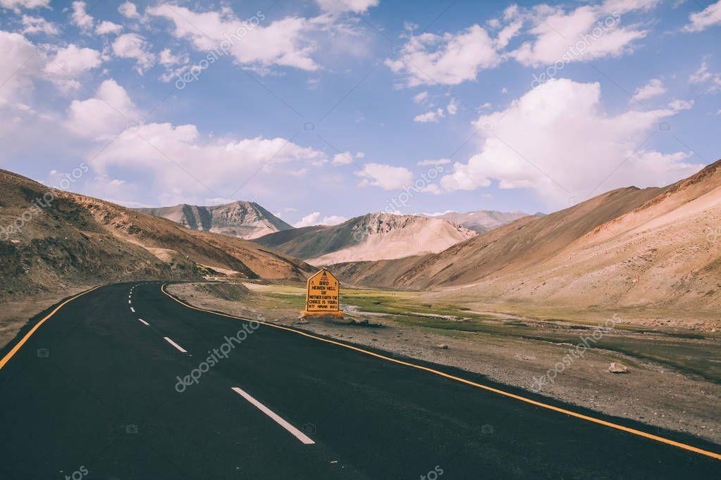 asphalt road with traffic sign in Indian Himalayas, Ladakh region