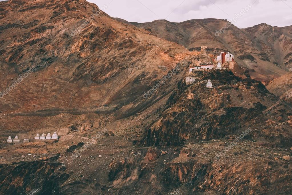 beautiful rocky mountains with traditional architecture in Indian Himalayas, Ladakh region