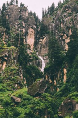 amazing majestic waterfall and rocks in indian himalayas