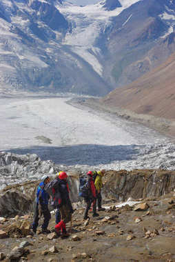 travelers hiking in snowy mountains, Russian Federation, Caucasus, July 2012