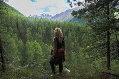 back view of woman looking at mountains, Altai, Russia