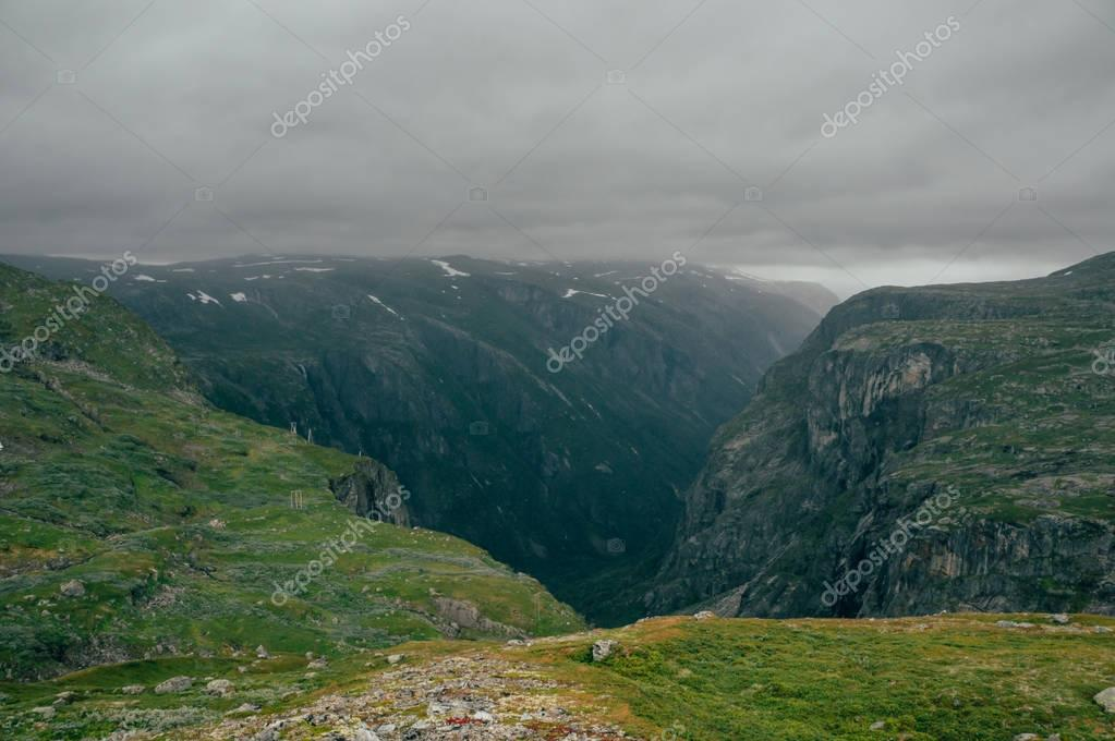 grassy slopes of rocks during foggy weather, Norway, Hardangervidda National Park