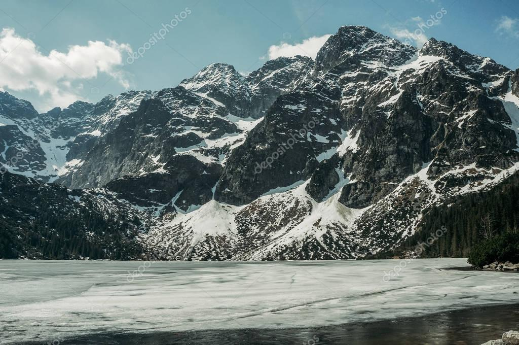 Frozen winter lake in scenic mountains, Morskie Oko, Sea Eye, Tatra National Park, Poland
