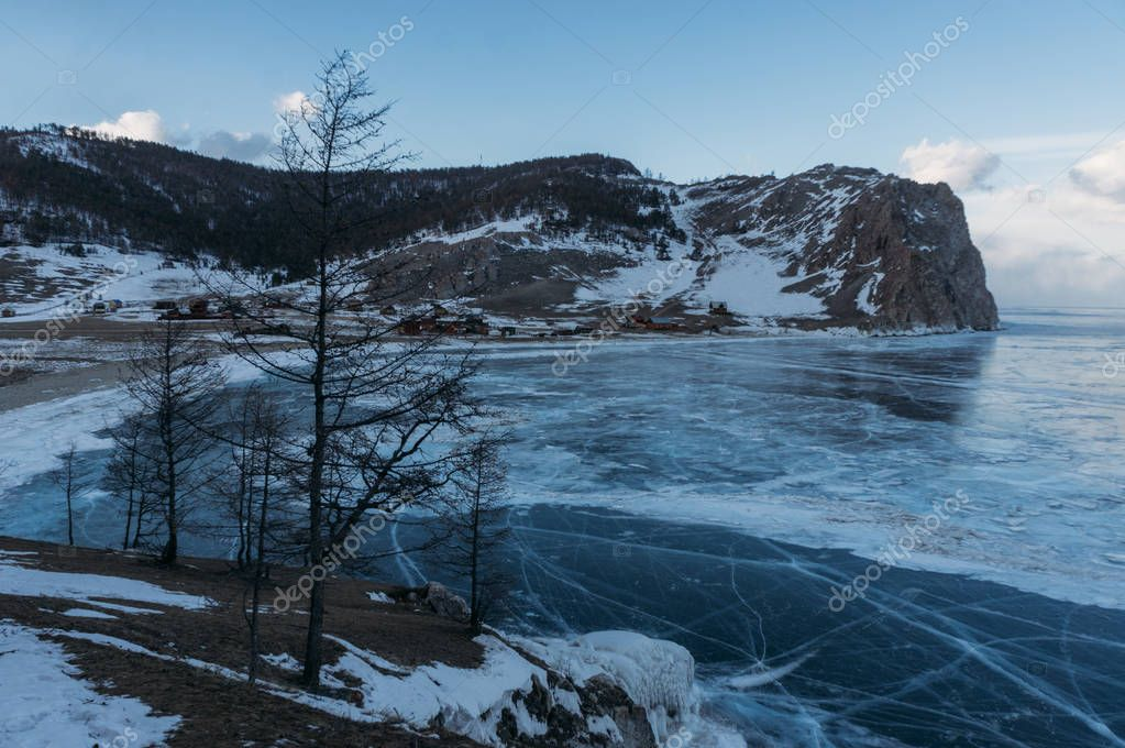 Frozen winter lake in scenic mountains, Russia, Lake Baikal