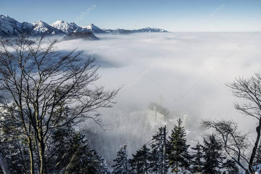 scenic view of snowy mountains in fog near Neuschwanstein Castle, Germany