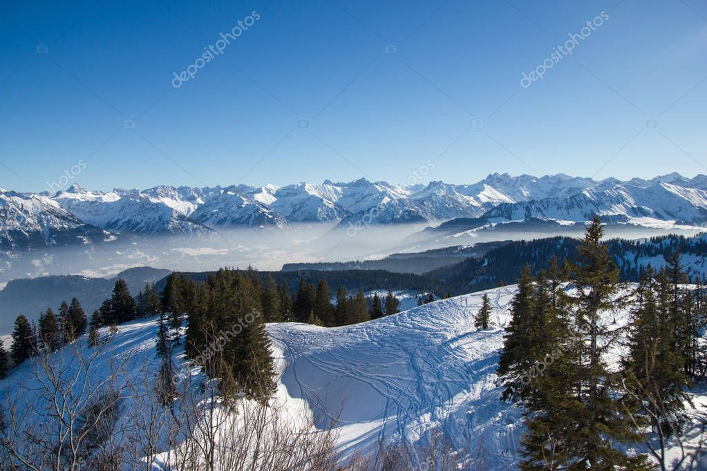 panoramic view of snowy mountains with trees in winter, Alps, Germany