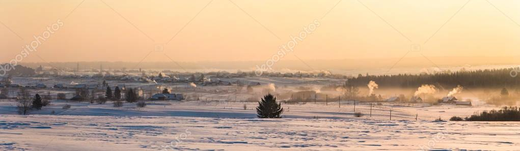 beautiful winter landscape and village at countryside at sunset, kazan region, russia