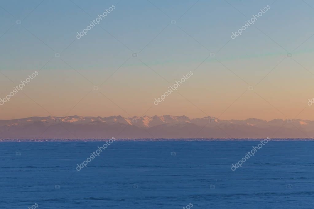 beautiful lake and mountains in fog at sunrise, Baikal, Russia