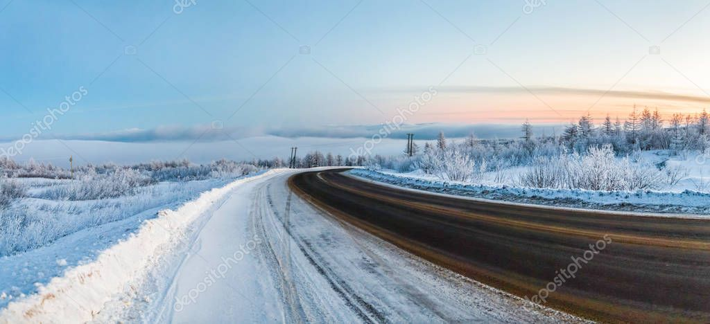 beautiful view of winter road and snow at sunset, magadan, russia