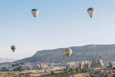 Mountain landscape with Hot air balloons in Goreme national park, fairy chimneys, Cappadocia, Turkey stock vector