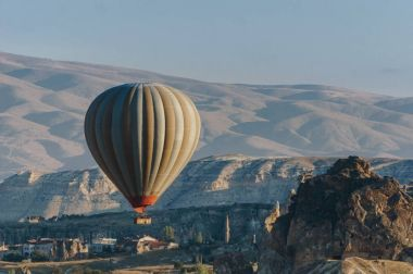 Hot air balloon flying in Goreme national park, fairy chimneys, Cappadocia, Turkey