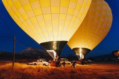 Hot air balloons near cars at night, Cappadocia, Turkey stock vector
