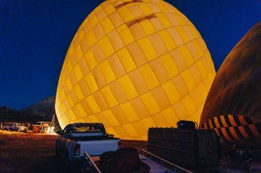 Hot air balloons at night, Cappadocia, Turkey stock vector