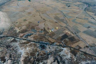 Aerial view of Hot air balloons in Goreme national park, fairy chimneys, Cappadocia, Turkey stock vector