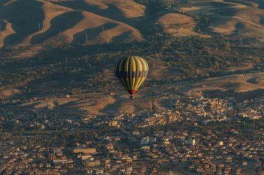 Aerial view of hot air balloon over fairy chimneys, Cappadocia, Turkey stock vector