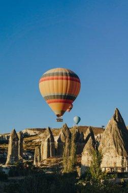 Hot air balloons festival in Goreme national park, fairy chimneys, Cappadocia, Turkey stock vector