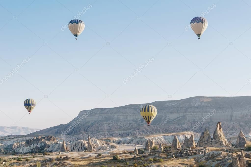 mountain landscape with Hot air balloons in Goreme national park, fairy chimneys, Cappadocia, Turkey