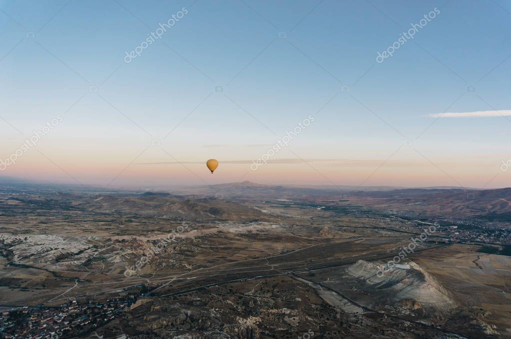 one hot air balloon flying Goreme national park, fairy chimneys, Cappadocia, Turkey