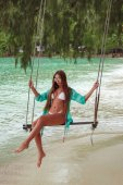 Fotografie beautiful girl in bikini on swing at tropical sea beach