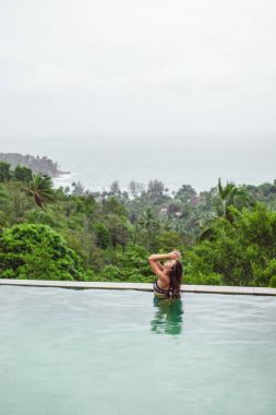 Beautiful girl in swimming pool on tropical resort stock vector