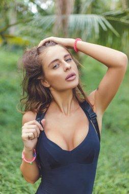 Attractive sensual girl posing on tropical resort stock vector