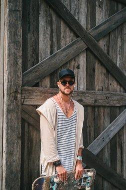 sunglasses and cap