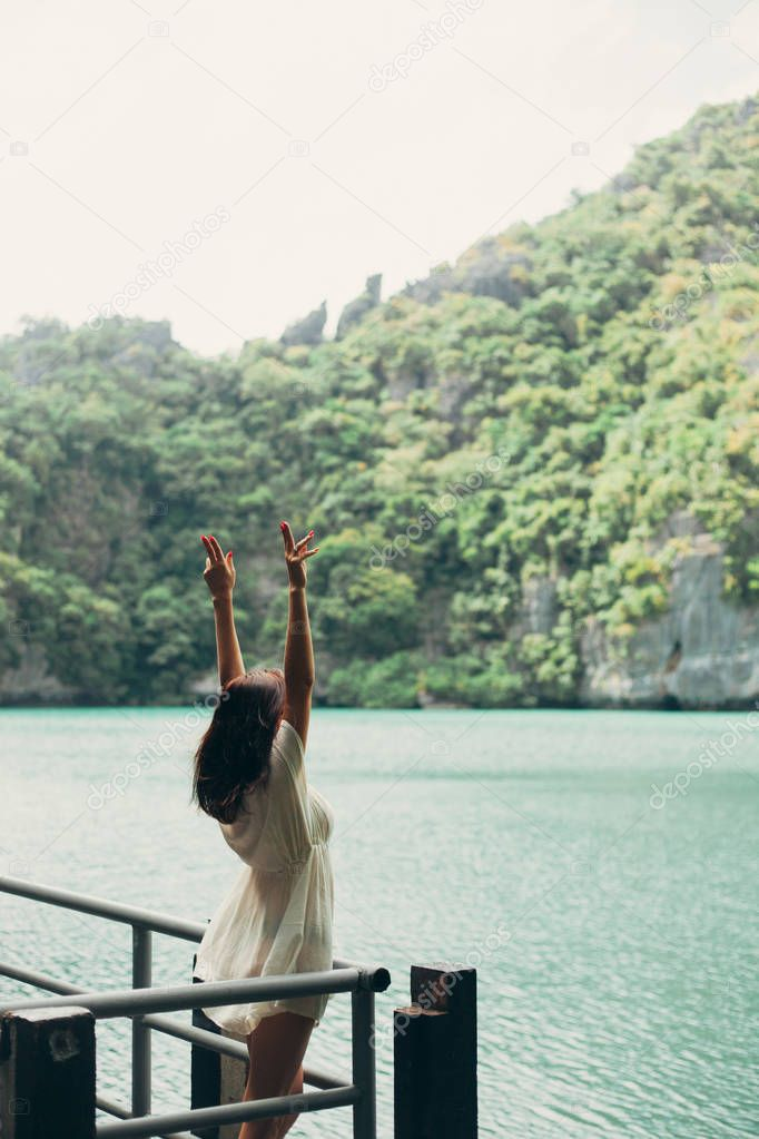 woman standing with hands up at Ang Thong National Park, Ko Samui, Thailand