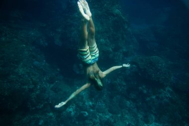 Partial view of man diving in ocean alone stock vector