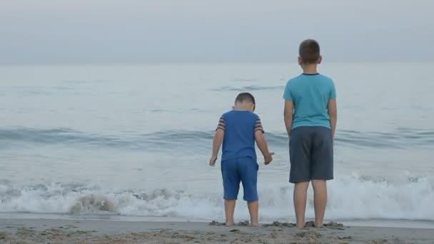 boys jump near the sea