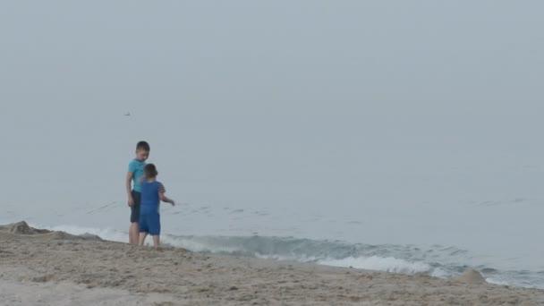 boys walk near the sea