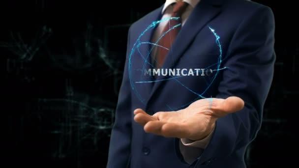 Üzletember mutatja koncepció hologram Communiccation a kezét