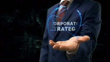 Businessman shows concept hologram Corporate strategy on his hand