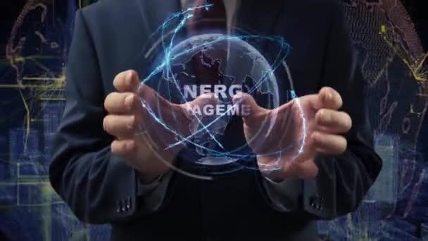 Mužské ruce aktivují hologram Energy Management