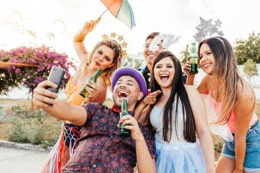 Brazilian Carnival. Group of friends in costumes taking a self portrait