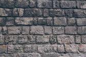 Close-up shot černé věku cihlové zdi pro pozadí