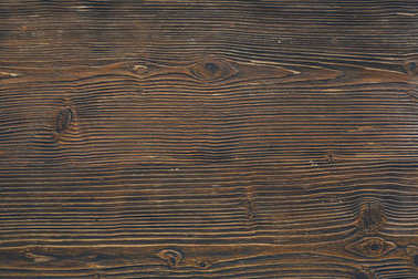 Close-up shot of dark wooden background