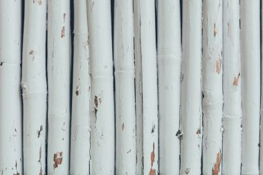 fence made of wooden logs painted in white for background