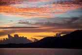 beautiful sunset seascape under cloudy sky