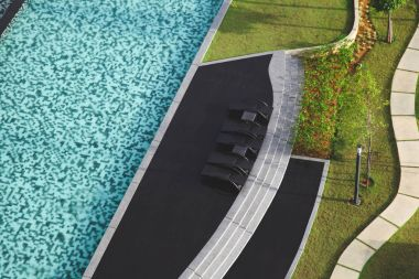 aerial view of swimming pool with sunbeds at hotel