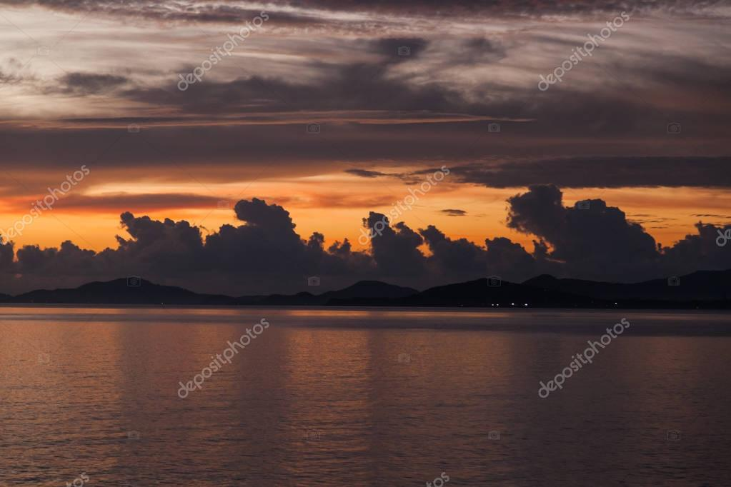 tranquil cloudy sunset sky over sea surface