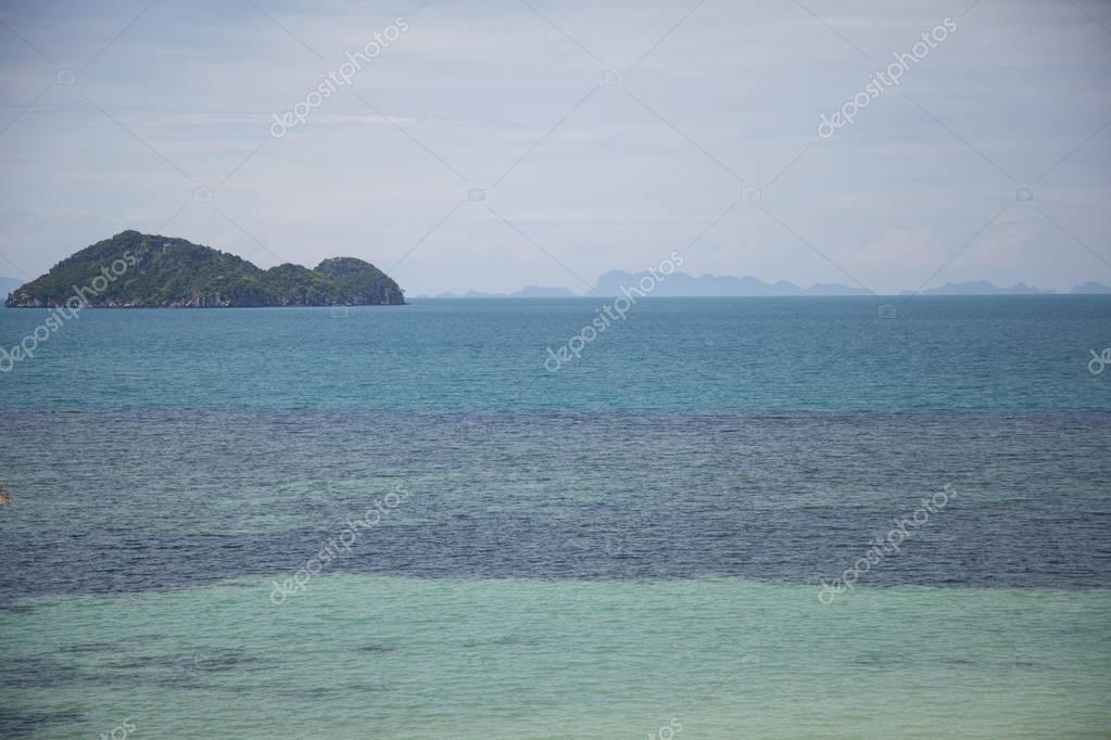 seascape with beautiful green island on cloudy day