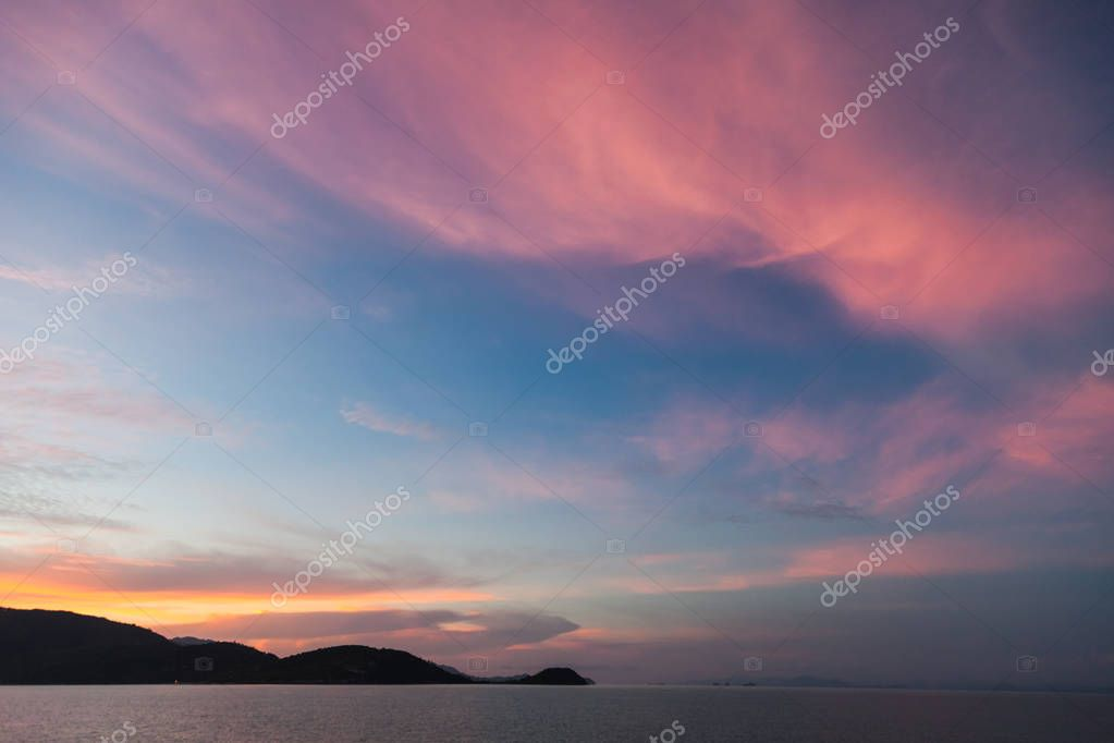 beautiful sunset seascape under pink cloudy sky