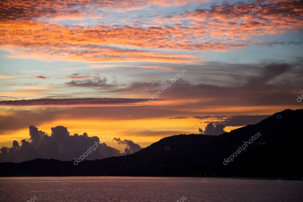beautiful sunset seascape under cloudy sky