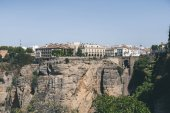 Photo scenic view of buildings on rock, Ronda, spain